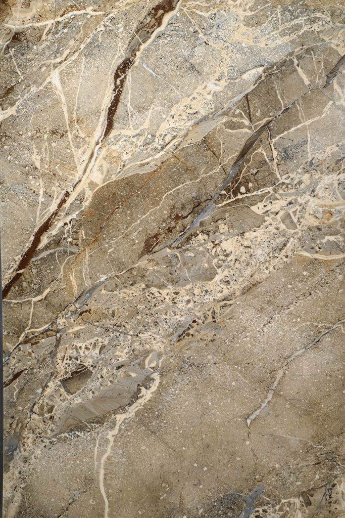 Ceramic porcelain stoneware tile texture or pattern. Natural stone brown color with veining